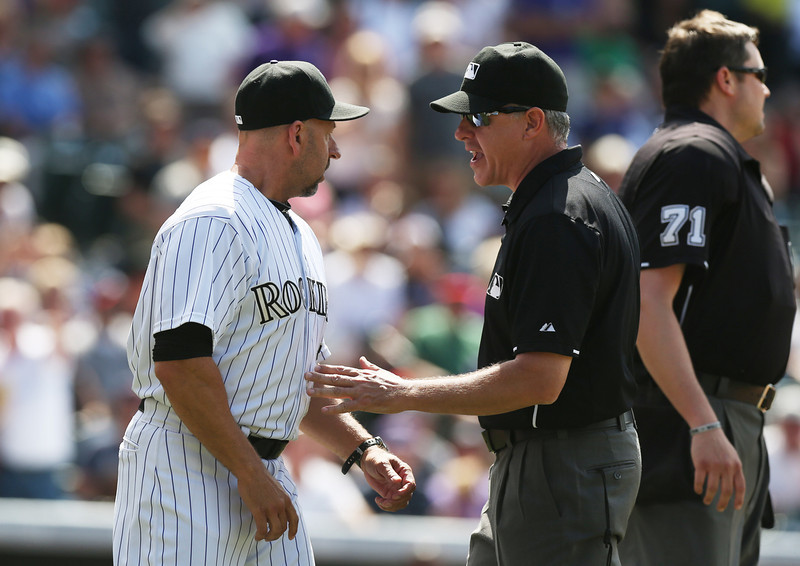 . Colorado Rockies manager Walt Weiss, left, argues with third base umpire Paul Emmel, center as home plate umpire Jordan Baker, right, works to restore order on the field after ejecting Weiss against the Atlanta Braves in the eighth inning of the Rockies\' 10-3 victory in a baseball game in Denver on Thursday, June 12, 2014. Weiss was tossed from the game for arguing after Rockies\' batter Corey Dickerson was plunked by a pitch thrown by Braves relief pitcher David Carpenter. (AP Photo/David Zalubowski)
