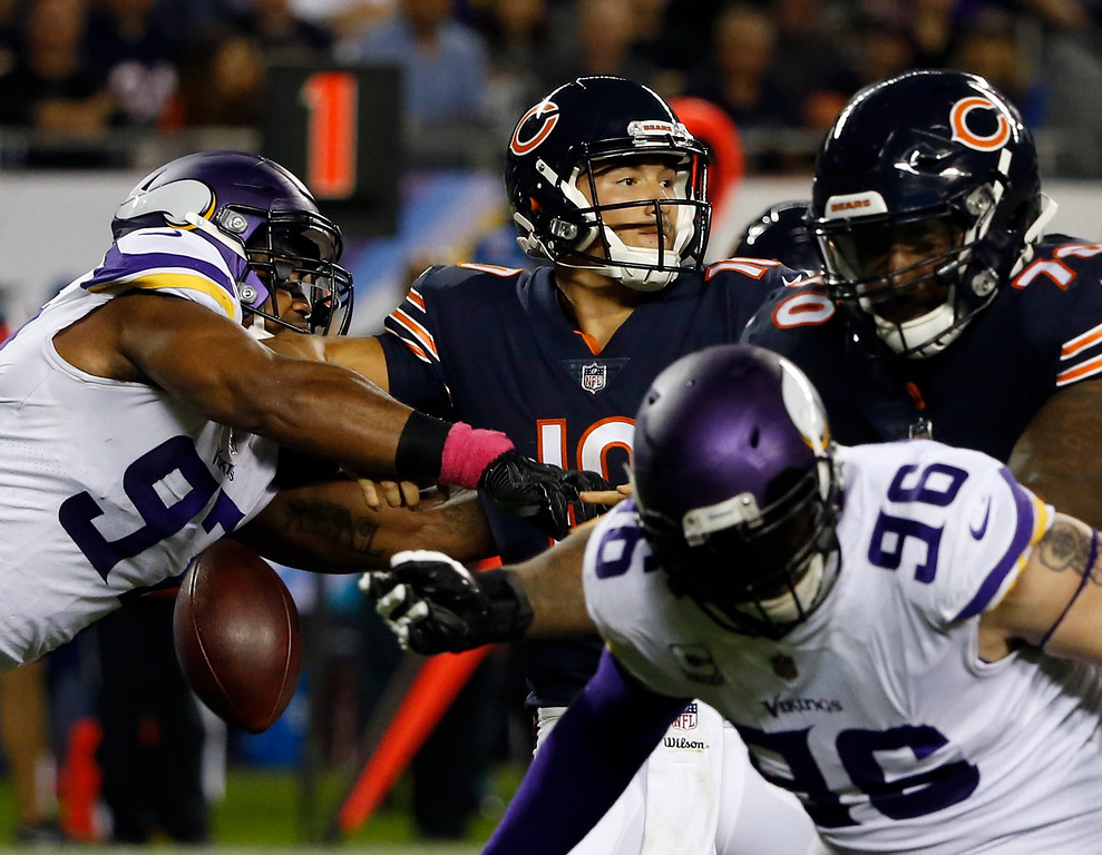 . Minnesota Vikings defensive end Everson Griffen (97) strips the ball from Chicago Bears quarterback Mitchell Trubisky (10) during the first half of an NFL football game, Monday, Oct. 9, 2017, in Chicago. (AP Photo/Charles Rex Arbogast)