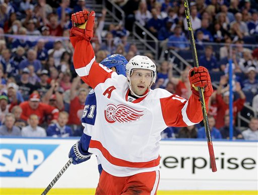 . Detroit Red Wings center Pavel Datsyuk (13), of Russia, celebrates his goal against the Tampa Bay Lightning during the first period of Game 1 of an NHL Eastern Conference playoff hockey series Thursday, April 16, 2015, in Tampa, Fla. (AP Photo/Chris O\'Meara)