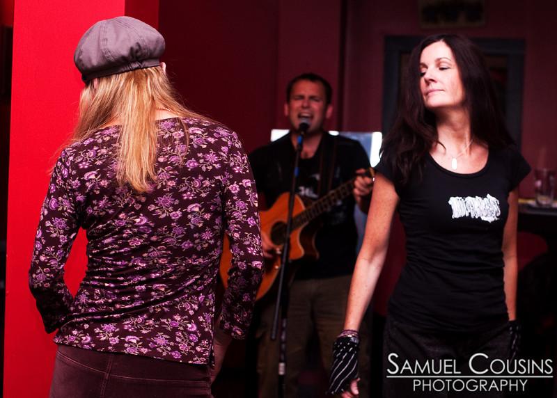 Women dancing while Adam Kurtz performs at Slainte