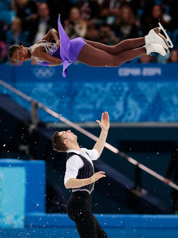 . Vanessa James and Morgan Cipres of France compete in the team pairs short program figure skating competition at the Iceberg Skating Palace during the 2014 Winter Olympics, Thursday, Feb. 6, 2014, in Sochi, Russia. (AP Photo/Ivan Sekretarev)