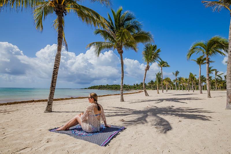 Lina Stock sitting on a beach in Playa del Carmen, Mexico