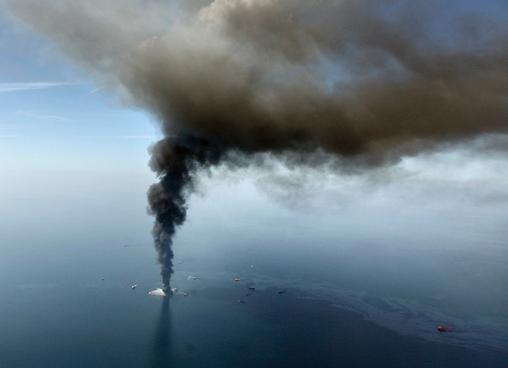 . FILE - In this April 21, 2010 file photo by Gerald Herbert, the Deepwater Horizon oil rig burns in the Gulf of Mexico.  (AP Photo/Gerald Herbert, File)