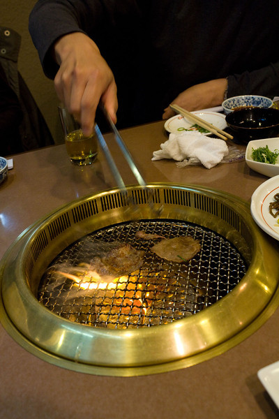Yakiniku (grilled meat). Cooking all sorts of yummy meat on a grill in the center of the table
