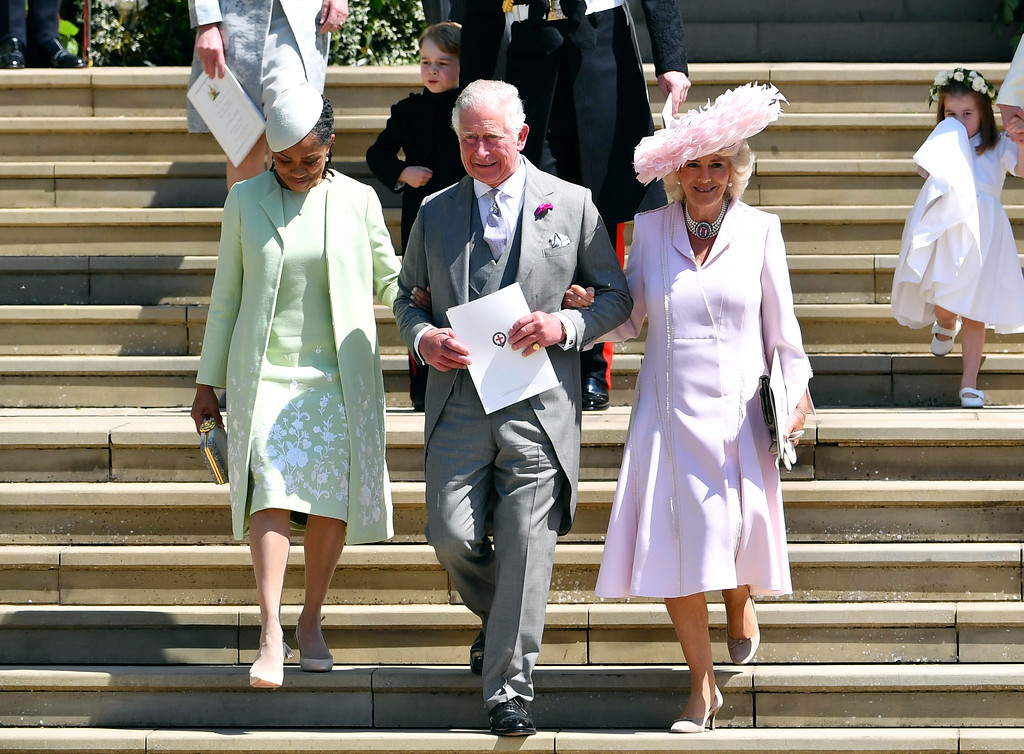 . Britain\'s Prince Charles, center, leaves with Doria Ragland, left, and Camilla Duchess of Cornwall after the wedding ceremony of Prince Harry and Meghan Markle at St. George\'s Chapel in Windsor Castle in Windsor, near London, England, Saturday, May 19, 2018. (Ben Stansall/pool photo via AP)
