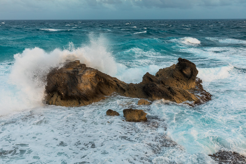 Watched these rocks do battle with the sea for a while. The rocks held their own.  Declared it a draw.