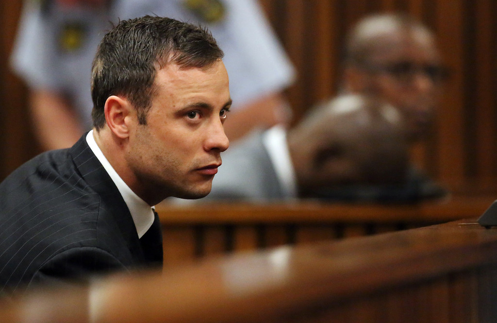 . South African Paralympic athlete Oscar Pistorius listens to the verdict in his murder trial in the High Court in Pretoria on September 12, 2014, where he was found guilty of culpable homicide..  SIPHIWE SIBEKOSIPHIWE SIBEKO/AFP/Getty Images