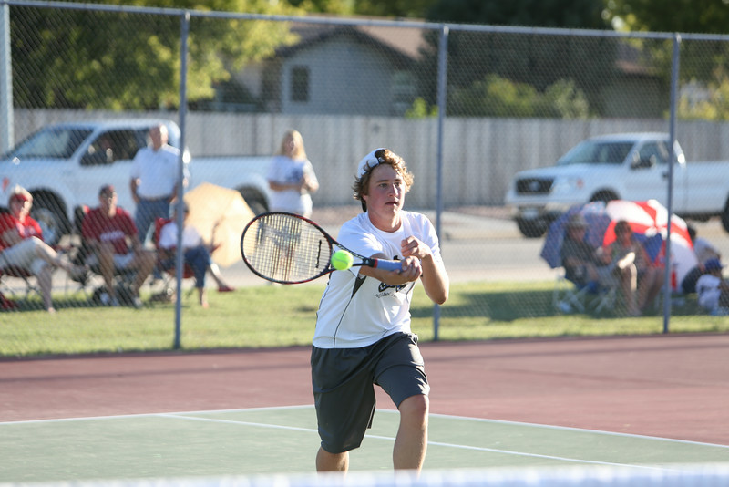 Alliance's number one Brian Gould in a match against Scottsbluff's number one on Tuesday in Gering.