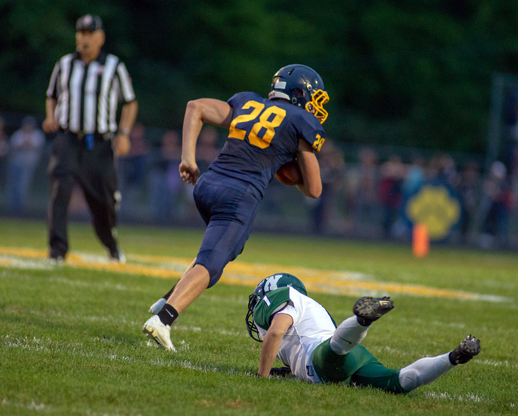 . Aimee Bielozer - The Morning Journal<br> Olmsted Falls\' Caiden Fetterman breaks away from the Westlake defense for a touchdown on Sept. 7.
