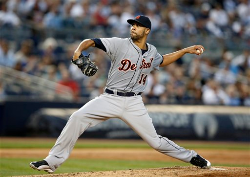 . Making his debut pitching appearance as a Tiger, Detroit Tigers starting pitcher David Price delivers in the second inning of a baseball game against the New York Yankees at Yankee Stadium in New York, Tuesday, Aug. 5, 2014.  (AP Photo/Kathy Willens)
