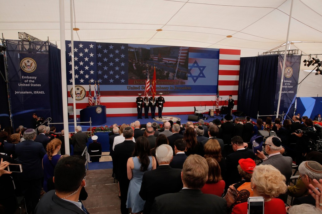 . Presentation of colors by U.S Marines and singing of the U.S national anthem during the opening ceremony of the new US embassy in Jerusalem, Monday, May 14, 2018. Amid deadly clashes along the Israeli-Palestinian border, President Donald Trump�s top aides and supporters on Monday celebrated the opening of the new U.S. Embassy in Jerusalem as a campaign promised fulfilled. (AP Photo/Sebastian Scheiner)