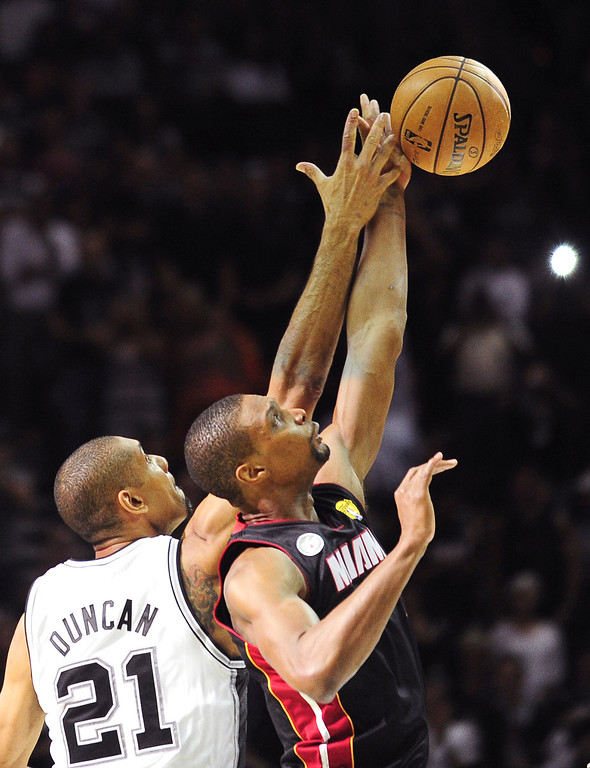 . Chris Bosh (R) of the Miami Heat vies for the tipoff with Tim Duncan (L) of the San Antonio Spurs during game 4 of the NBA finals on June 13, 2013 in San Antonio, Texas.  AFP PHOTO/Frederic J. BROWNFREDERIC J. BROWN/AFP/Getty Images