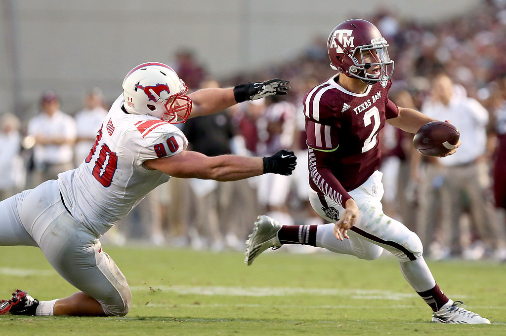 . HOUSTON, TX- SEPTEMBER 21: Johnny Manziel #2 of the Texas A&M Aggies rushes past Zach Wood #90 of the Southern Methodist Mustangs in the first half on September 21, 2013 at Kyle Field in College Station, Texas. (Photo by Thomas B. Shea/Getty Images)