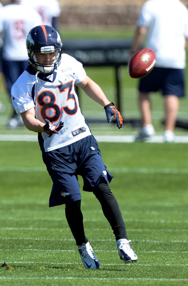 . Wes Welker of the Denver Broncos flips the football after catching a pass during the teams OTAs May 20, 2013 at Dove Valley. All offseason training activities (OTAs) are voluntary until the mandatory minicamp June 11-13. (Photo By John Leyba/The Denver Post)