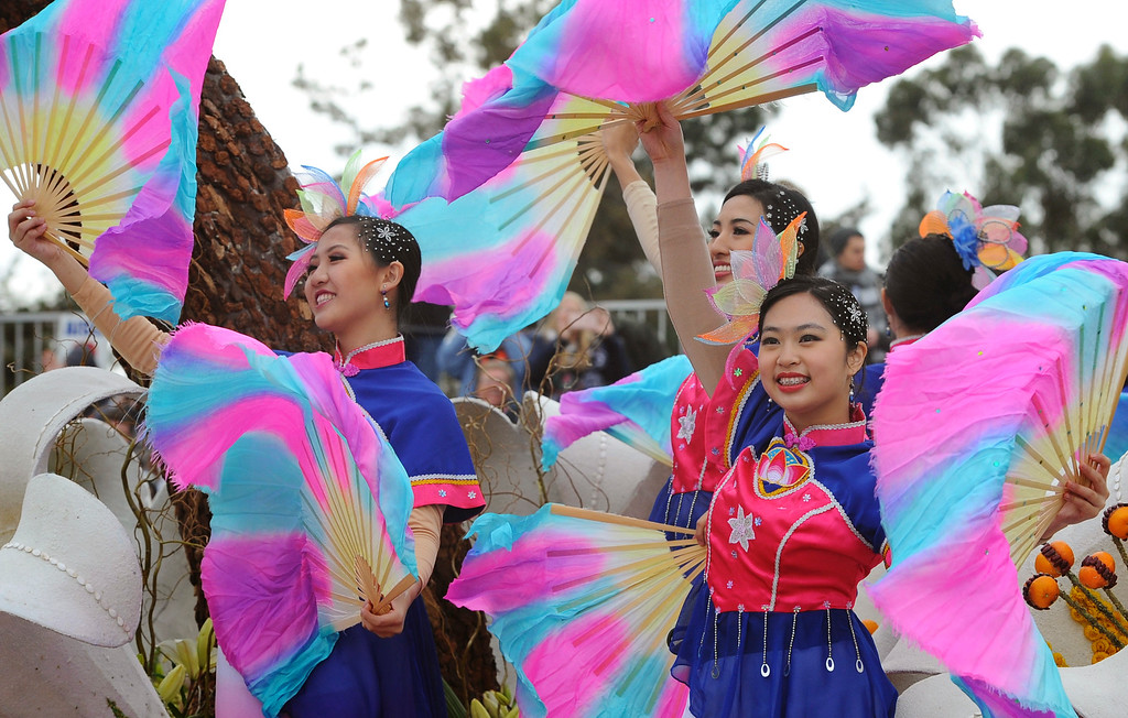 ". Dancers perform onto of the China Airlines float ""Return to the Beauty of Taiwan,\"" as it rolls along the 128th Rose Parade in Pasadena, Calif., Monday, Jan. 2, 2017. The 5½-mile parade featured marching bands, horseback riders and dozens of ornately decorated flower-covered floats. (AP Photo/Michael Owen Baker)"