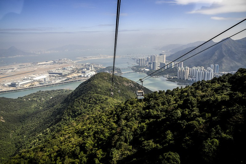 Our trip (back) to Lantau Island.  The amazing glass-bottomed cable car whisked us over the mountains giving great views of the airport and local town.