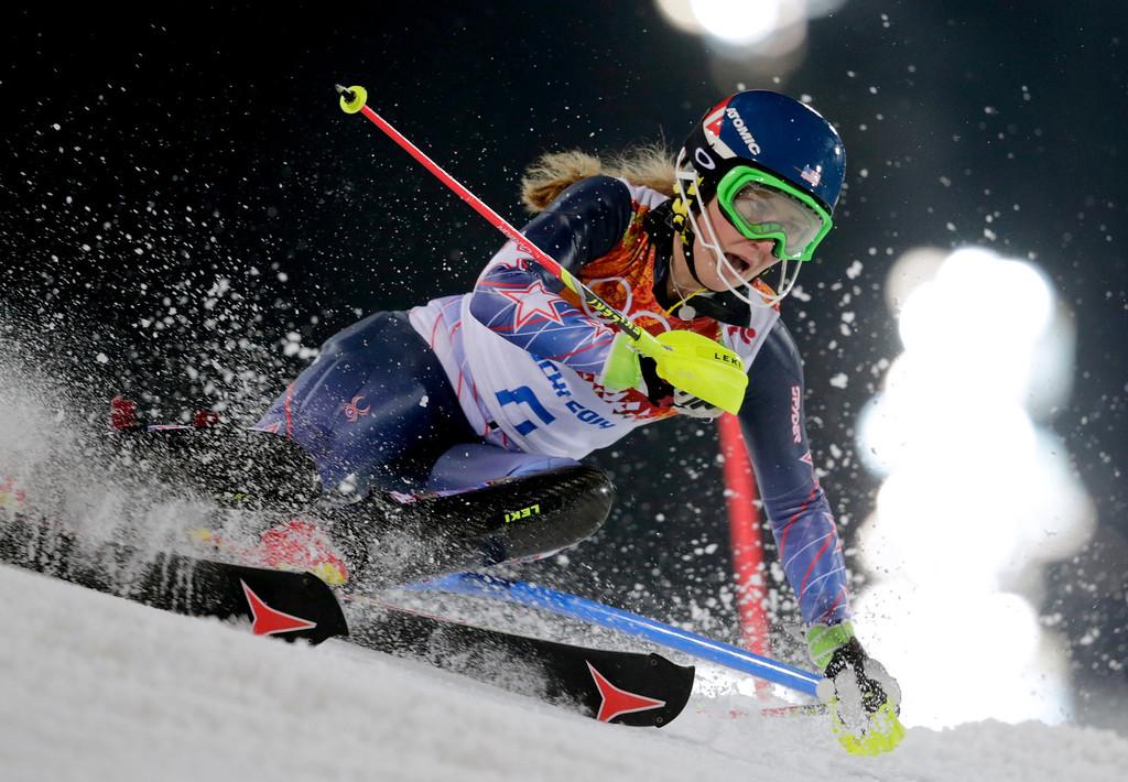 . Gold medal winner Mikaela Shiffrin skis past a gate in the women\'s slalom at the Sochi 2014 Winter Olympics, Friday, Feb. 21, 2014, in Krasnaya Polyana, Russia. (AP Photo/Charles Krupa)