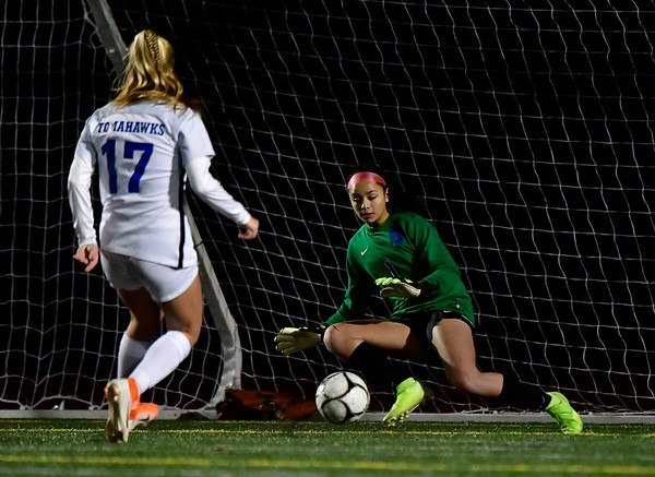 11/23/2019 Mike Orazzi | Staff Southington High School's Emily Eigo (1) and Glastonbury's Samantha Forrest (17) during the Class LL Girls State Soccer Tournament at Veterans Stadium in New Britain Saturday evening. Glastonbury won 1-0.