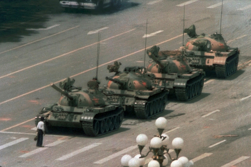 . In this June 5, 1989 photo, a Chinese man stands alone to block a line of tanks heading east on Beijing\'s Changan Blvd. from Tiananmen Square in Beijing. (AP Photo/Jeff Widener)