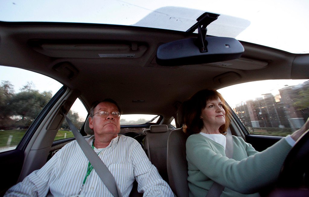. Jan Richards, right, drives her husband Gary, also known as Mr. Roadshow, home in their Toyota Prius from the San Jose Mercury News office in San Jose, Calif., on March 4, 2013.  Richards is writing a column about how he cannot drive for six to eight months while his right foot heals. The theme is how this affects the Merc\'s Mr. Roadshow columnist and now is an issue that many older motorists will be facing as our population ages and driving skills diminish.  His wife Jan must now drive him everywhere he needs to go, including to and from work until his foot heals.  (Nhat V. Meyer/Staff)