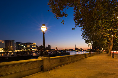 Battersea Bridge at dusk seen from Chelsea Embankment, London, United Kingdom
