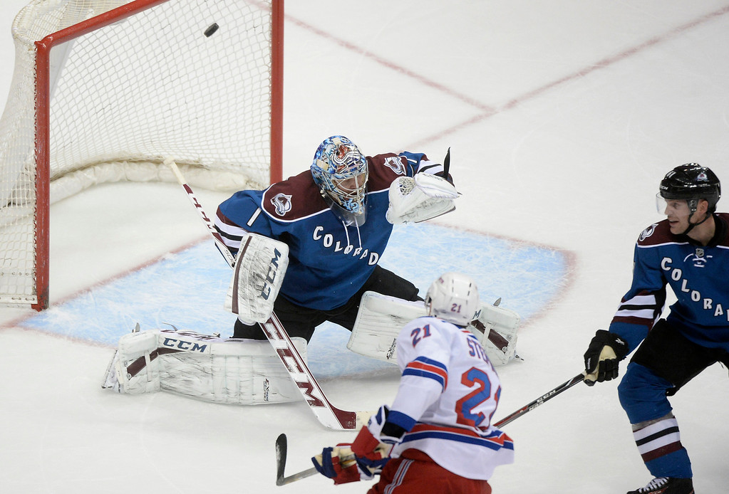 . New York center Derek Stepan (21) lifted a shot past Colorado goalie Semyon Varlamov (1) in the second period.   (Photo by Karl Gehring/The Denver Post)