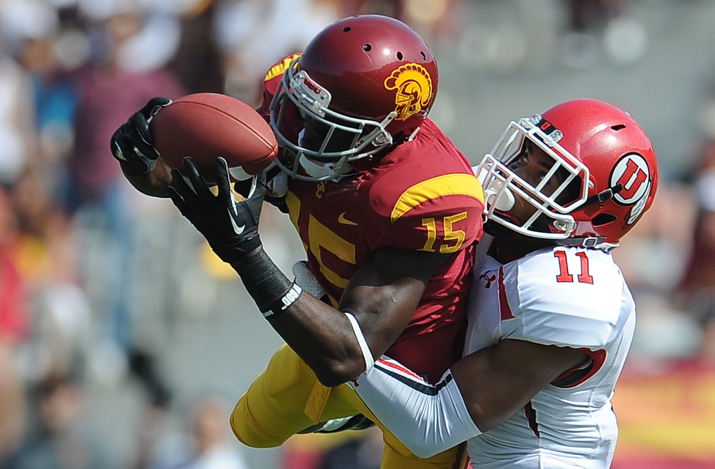 . Southern California wide receiver Nelson Agholor (15) catches a pass then drops the ball on contact with the ground over Utah\'s Davion Orphey (11) during the first half of an NCAA college football game in the Los Angeles Memorial Coliseum in Los Angeles, on Saturday, Oct. 26, 2013.  (Photo by Keith Birmingham/Pasadena Star-News)