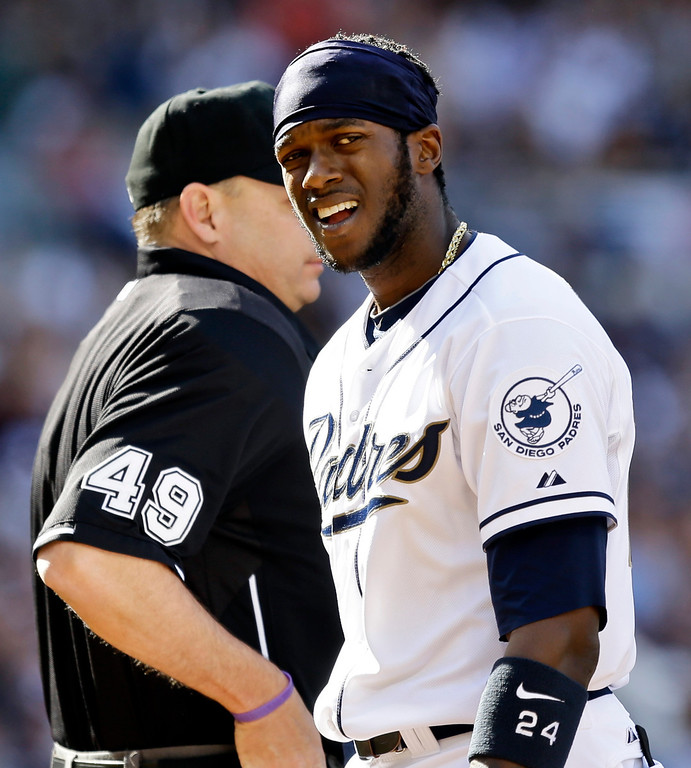 . San Diego Padres\' Cameron Maybin reacts after being called out on strikes by umpire Andy Fletcher while batting against the Los Angeles Dodgers during a baseball game in San Diego, Tuesday, April 9, 2013. (AP Photo/Lenny Ignelzi)