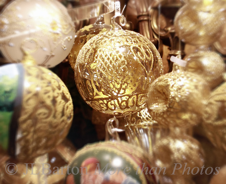 Choose an ornament 2012-11-30  Continuing the theme of advent markets, here is a detail shot from one of the stands at Vienna's largest such market - the one at the Rathaus.  I'm off for the next three days selling cards and calendars in the wine cellar where my vintner holds an annual advent event. Many thanks for the kind comments yesterday - the shot made it into the top ten.