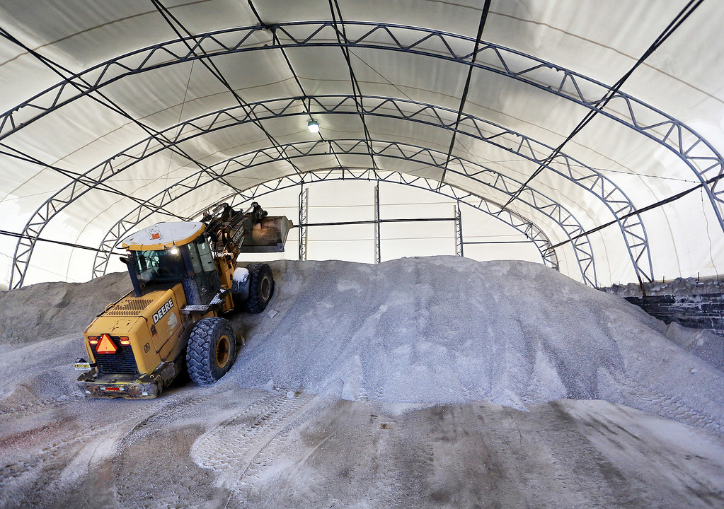 . Scranton Department of Public Works heavy equipment operator Bob Pugliese makes room for 1,000 tons of salt that will be used in upcoming snow storms in Scranton, Pa., Monday, Jan. 26, 2015. More than 35 million people along the Philadelphia-to-Boston corridor rushed to get home as a fearsome storm swirled in with the potential for hurricane-force winds and 1 to 3 feet of snow that could paralyze the Northeast for days. (AP Photo/The Times-Tribune, Jake Danna Stevens) WILKES-BARRE TIMES-LEADER OUT; MANDATORY CREDIT