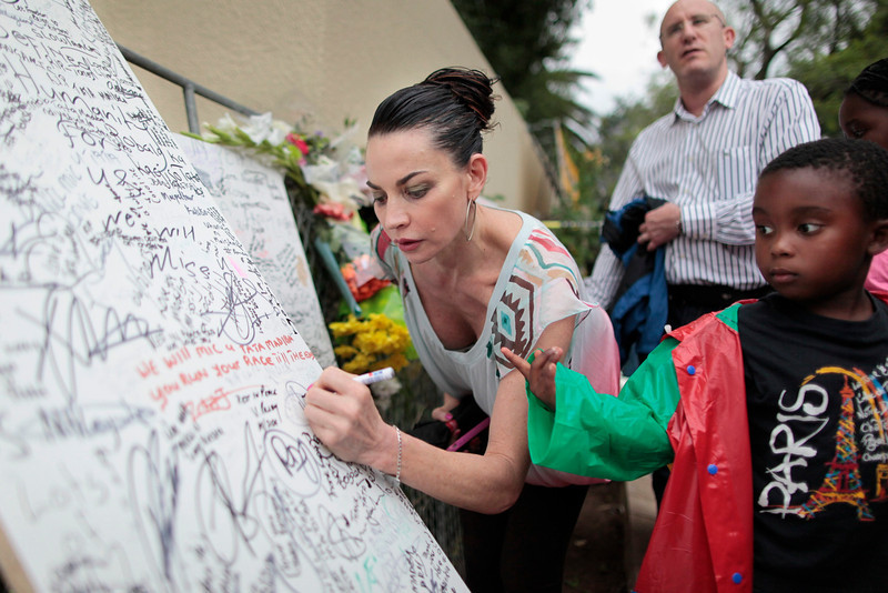 . A woman writes a message on a board for the late South African president Nelson Mandela outside his house in Johannesburg, South Africa, 06 December 2013. Nobel Peace Prize winner Nelson Mandela died at age 95, in Johannesburg, South Africa, on 05 December 2013. A former lawyer, Mandela was the first black President of South Africa voted into power after the countries first free and fair democratic elections that witnessed the end of the Apartheid system in 1994. Mandela was founding member of the ANC (African National Congress) and anti-apartheid activist who served 27 years in prison, spending many of these years on Robben Island. In South Africa, Mandela is often known as Tata Madiba, an honorary title adopted by elders of Mandela\'s clan. Mandela won the Nobel Peace Prize in 1993.  EPA/DAI KUROKAWA
