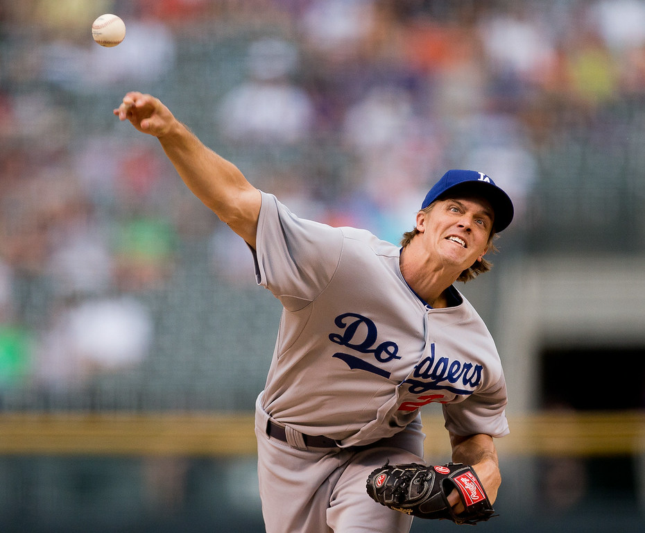 . Starting pitcher Zack Greinke #21 of the Los Angeles Dodgers delivers to home plate during the first inning against the Colorado Rockies at Coors Field on July 3, 2014 in Denver, Colorado.  (Photo by Justin Edmonds/Getty Images)