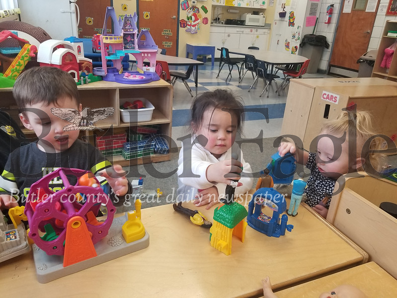 From left, Landon, Kalani and Caroline play in the Elmo Room at Lifesteps in Butler Township. Lifesteps offers 65 programs and services to county residents from age six weeks to senior citizens.