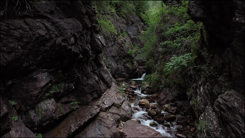 Available in 4k - A beautiful small canyon stream travelling shot in the Aragonese Pyrenees mountain range in the Valley of Gistain
