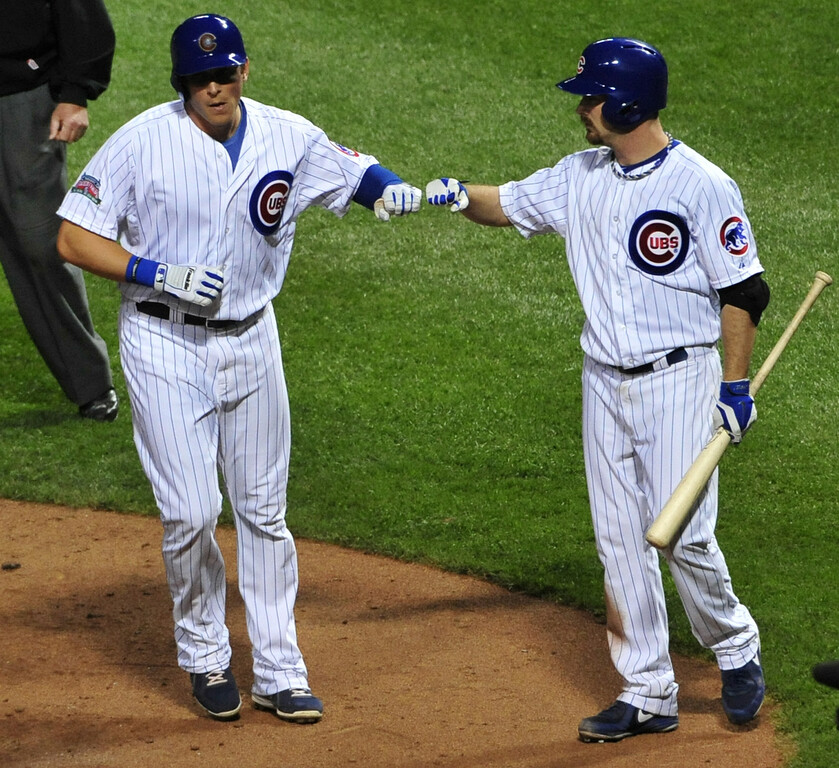 . CHICAGO, IL - JULY 30:  Ryan Sweeney #6 of the Chicago Cubs is greeted by Travis Wood #37 after scoring against the Colorado Rockies during the fifth inning on July 30, 2014 at Wrigley Field in Chicago, Illinois. (Photo by David Banks/Getty Images)