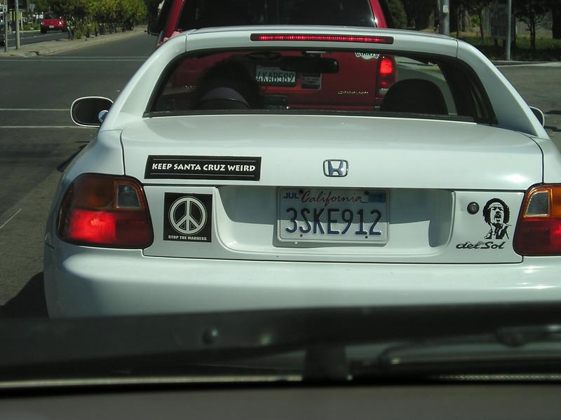 "Leaving Santa Cruz, such typical sort of bumper stickers: A peace sign and ""Keep Santa Cruz weird."""