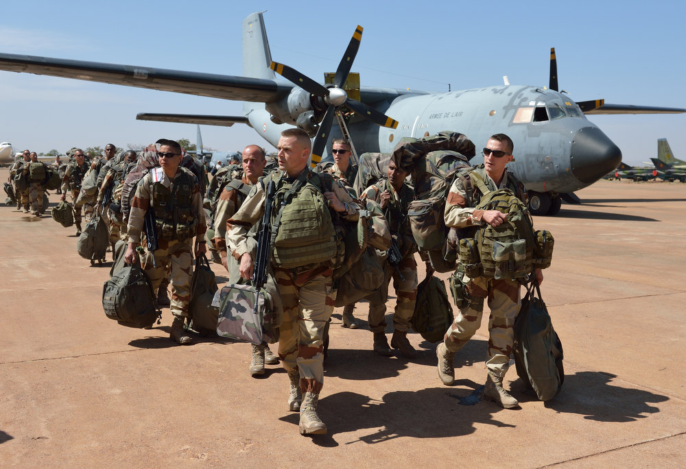 """. French troops from the \""""Licorne\"""" operation based in Abidjan (Ivory Coast) arrive at the 101st military airbase near Bamako on January 15, 2013 to reinforce the \""""Serval\"""" operations, before their deployment in the north of Mali.France has deployed 700 troops in and around Paris, Interior Minister Manuel Valls revealed Tuesday in the latest indicator of mounting concern over potential reprisals for military intervention in Mali. Leaders of the militant Islamist groups under attack in the West African state have warned that France has \""""opened the doors of hell\"""" by unleashing its warplanes and have called on fellow extremists to hit back on French soil. ERIC FEFERBERG/AFP/Getty Images"""