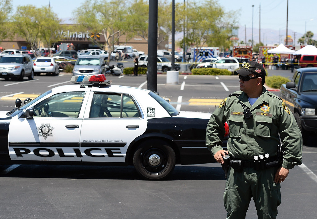 . A Las Vegas Metropolitan Police Department officer stands in a parking lot at a Wal-Mart on June 8, 2014 in Las Vegas, Nevada.  (Photo by Ethan Miller/Getty Images)