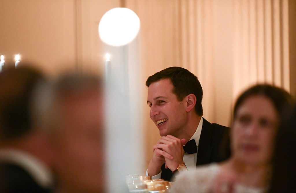 . White House adviser Jared Kushner, center, attends a State Dinner with President Donald Trump and French President Emmanuel Macron at the White House in Washington, Tuesday, April 24, 2018. (AP Photo/Susan Walsh)