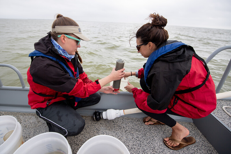 Danielle Zimmermann and Natasha Breaux collect a sediment sample in Baffin Bay.