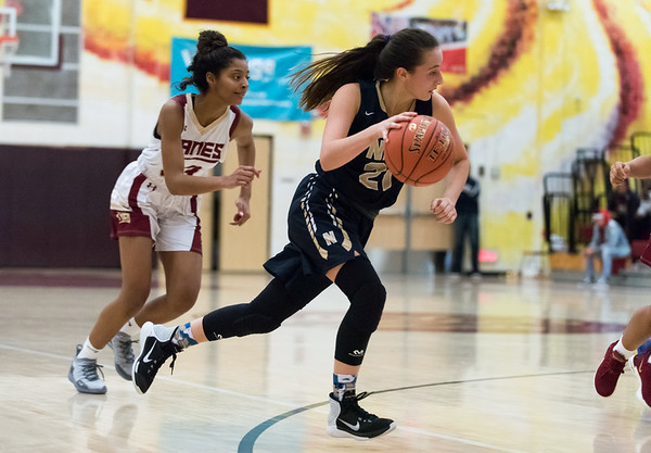 12/10/18 Wesley Bunnell | Staff New Britain girls basketball was defeated 52-39 at home against Newington on Thursday evening. Abygale Flores (21).