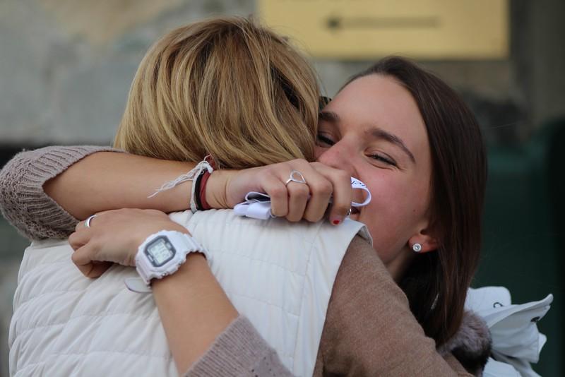 Charlotte giving her mom a hug