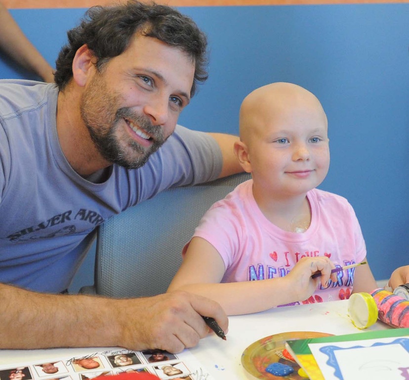 ". 04-18-2013-(LANG Staff Photo by Sean Hiller)-Toyota Grand Prix Celebrities visited Miller�s Children�s Hospital to visit the children they are raising money for through ""Racing for Kids.\""  Celebrity driver Jeremy Sisto meets with patient Sydney Waldrop."