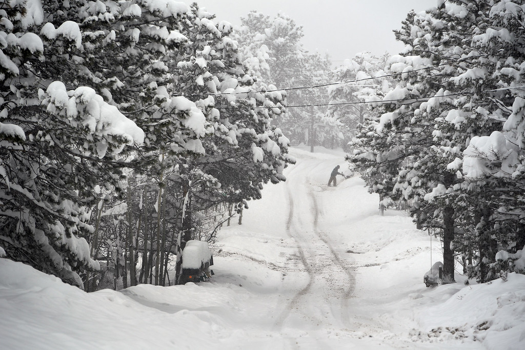 . NEDERLAND, CO - APRIL 17: Mark Weber, in the distance, uses a snowplow to clear his driveway of over 35 inches of snow on April 17, 2016 in Nederland, Colorado. A slow moving spring storm dumped almost 3 feet of snow over a two day period in the foothills. (Photo by Helen H. Richardson/The Denver Post)