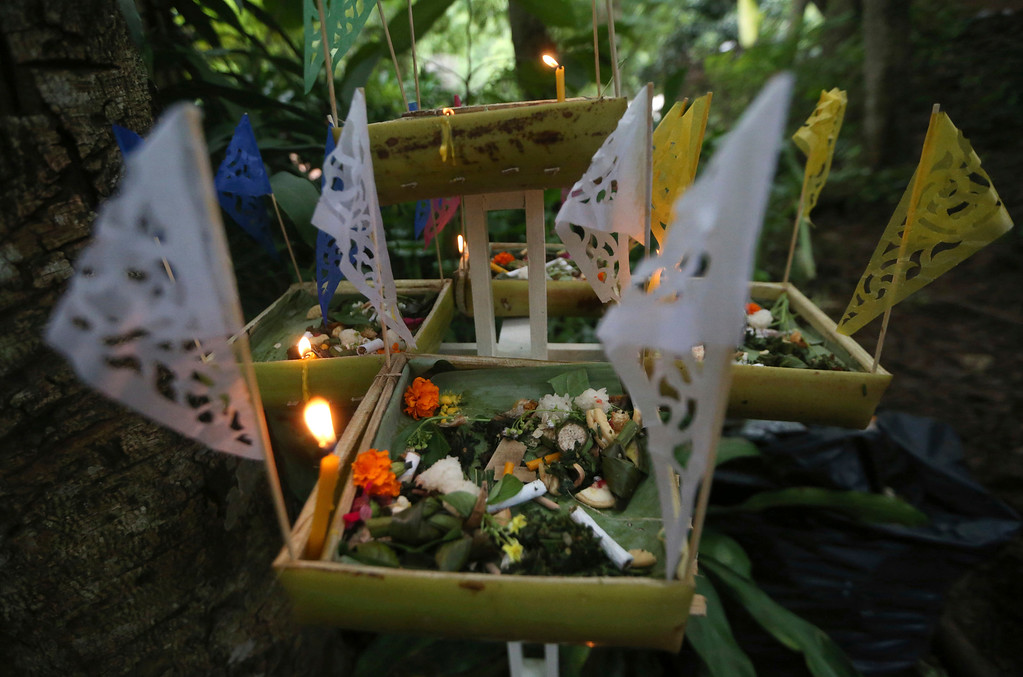 . Prayer offerings are placed near a cave where 12 boys and their soccer coach went missing, in Mae Sai, Chiang Rai province, in northern Thailand, Sunday, July 1, 2018. The frantic effort to locate them in the cave for a week picked up pace as a break in the rain eased flooding in the system of caverns and more experts from around the world joined the anxious rescue mission. (AP Photo/Sakchai Lalit)