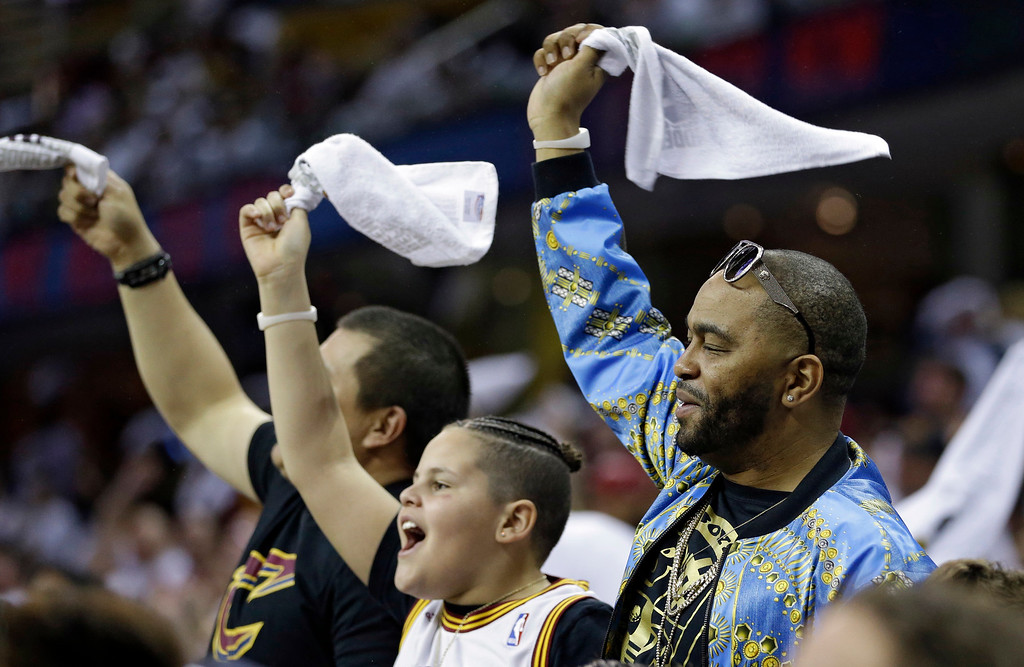 . Cleveland Cavaliers fans celebrate in the second half in Game 1 of a first-round NBA basketball playoff series against the Indiana Pacers, Saturday, April 15, 2017, in Cleveland. (AP Photo/Tony Dejak)