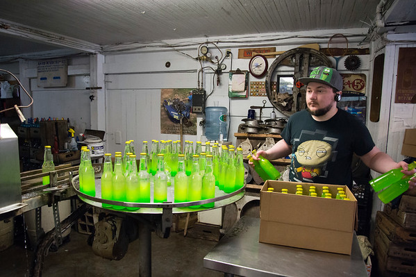 03/09/20 Wesley Bunnell | Staff Anthony Martone gives bottles of Coronovirus Cocktail a final agitation before being placed into boxes to be labeled at Avery's Soda on Monday afternoon.