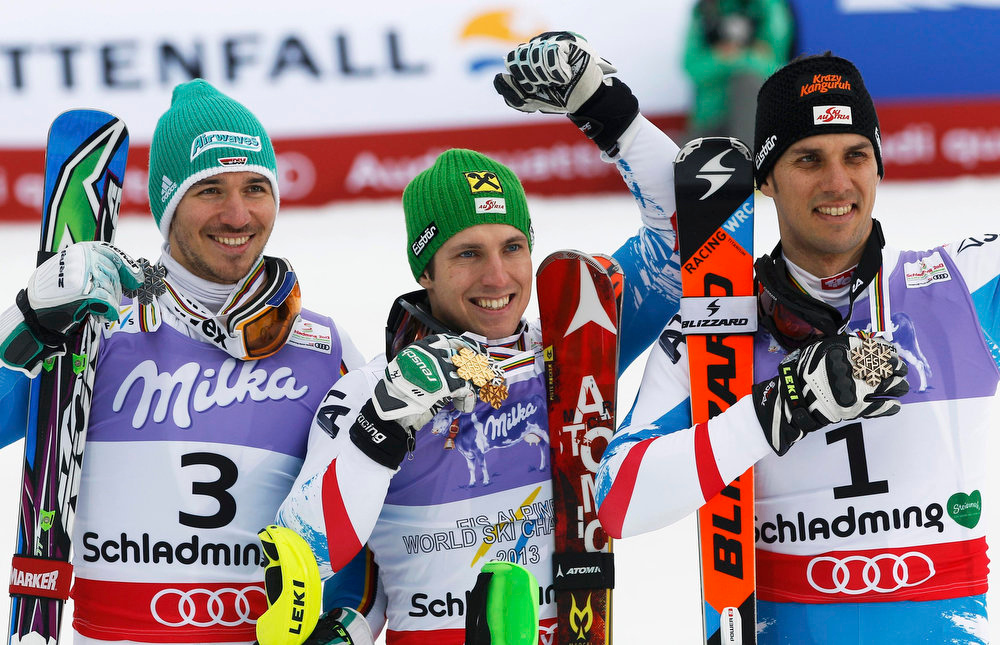 Description of . (L to R) Silver medallist Felix Neureuther of Germany, gold medallist Marcel Hirscher of Austria and bronze medallist Mario Matt of Austria celebrate after the men\'s Slalom race at the World Alpine Skiing Championships in Schladming February 17, 2013.          REUTERS/Leonhard Foeger