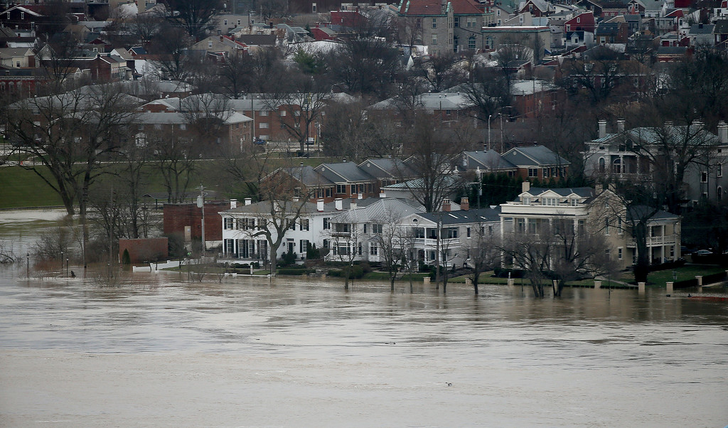 . The Ohio River overflows the Covington, Ky., waterfront Sunday, Feb. 25, 2018. Far left of the photo is the Licking river. Heavy rains overnight have sent the swollen Ohio River at Cincinnati to its highest point in 20 years with the river expected to remain above flood stage through the end of the week, a National Weather Service meteorologist said Sunday. (Cara Owsley/The Cincinnati Enquirer via AP)