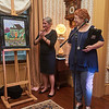 """University of West Florida President Martha Saunders hosted a private event at the Dorr House in downtown Pensacola to thank local artist Tracey Savery Davis for generously donating her original artwork, """"Oleander,"""" to the University."""